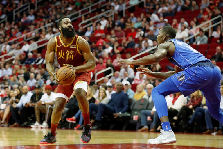 James Harden #13 of the Houston Rockets steps back for a three point shot in the first half defended by Dorian Finney-Smith #10 of the Dallas Mavericks at Toyota Center on February 11, 2019 in Houston, Texas. PHOTO/GettyImages