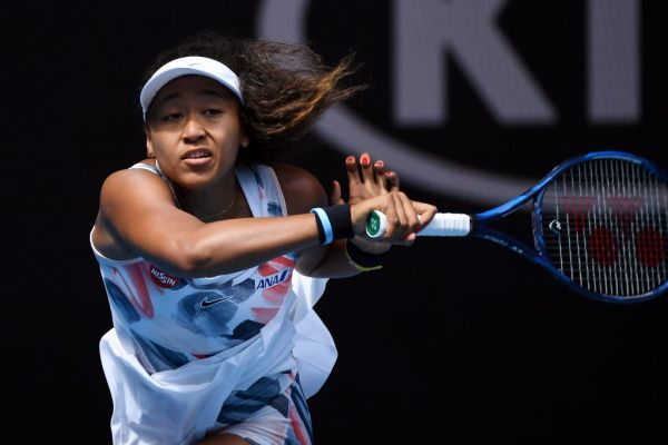 Japan's Naomi Osaka hits a return against China's Zheng Saisai during their women's singles match on day three of the Australian Open tennis tournament in Melbourne on January 22, 2020. PHOTO | AFP