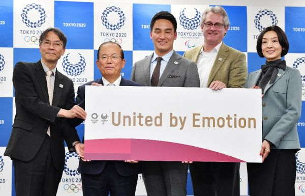 Japanese actor Tamiyo Kusakari (R), Paralympics swimmer Takeshi Matsuda and others holds a banner that the motto of Tokyo Olympics and Paralympics in Tokyo on Feb. 17, 2020. The Tokyo Organising Committee of the Olympic and Paralympic Games unveiled the motto, United by Emotion. PHOTO | AFP