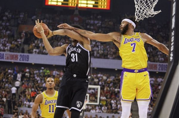 Jarret Allen of the Brooklyn Nets (L) and JaVale McGee of the Los Angeles Lakers compete for the ball during the National Basketball Association (NBA) pre-season match between the Los Angeles Lakers and Brooklyn Nets in Shenzhen, in China's southern Guangdong province on October 12, 2019. PHOTO | AFP