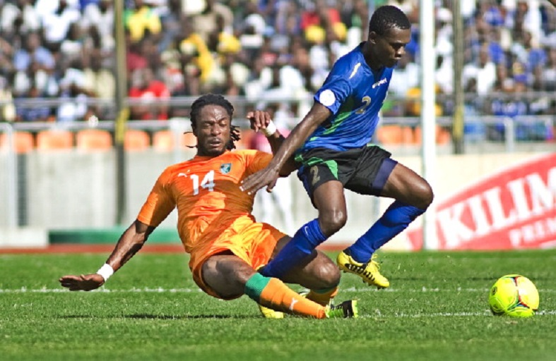 Jean Jacques Gosso of Ivory Coast vies for the ball with Salum Abubakar of Tanzania's Taifa Stars on June 16, 2013 during their 2014 World Cup qualifying match in the Tanzanian capital Dar es Salaam. AFP PHOTO/Tony KARUMBA .PHOTO/GETTY IMAGES