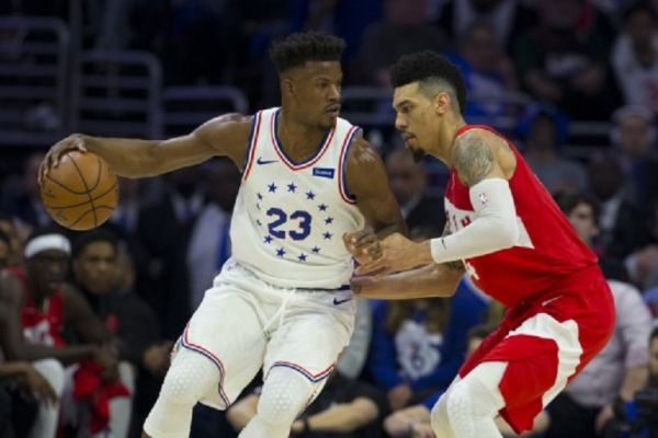 Jimmy Butler #23 of the Philadelphia 76ers dribbles the ball against Danny Green #14 of the Toronto Raptors in the first quarter of Game Six of the Eastern Conference Semifinals at the Wells Fargo Center on May 9, 2019 in Philadelphia, Pennsylvania. The 76ers defeated the Raptors 112-101. PHOTO/AFP