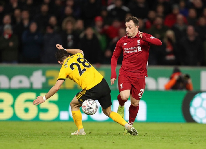 Joao Moutinho of Wolverhampton Wanderers and Xherdan Shaqiri of Liverpool during the Emirates FA Cup Third Round match between Wolverhampton Wanderers and Liverpool at Molineux on January 7, 2019 in Wolverhampton, United Kingdom.PHOTO/GETTY IMAGES