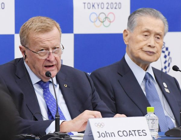 John Coates, chairman of the IOC Coordination Commission, and Yoshiro Mori, Tokyo Olympic Organising Commitee chairman, attend a press conference after officially announceing its decision to relocate the marathon and racing walk events site from Tokyo to Sapporo in Tokyo on Nov. 1, 2019. IOC aimed to avoid an extreme heat and humidity in Tokyo's August for athletes first policy. Yuriko Koike, Tokyo Metropolitan Governor will not agree with IOC decision, however, Tokyo government is considering accepting the proposed relocation of the 2020 Olympic marathon and racing walk. PHOTO | AFP