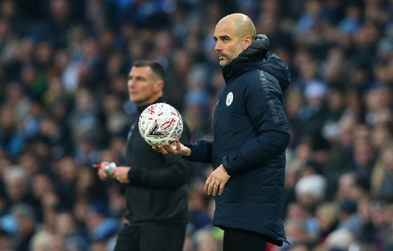 Josep Guardiola, Manager of Manchester City looks on during the FA Cup Third Round match between Manchester City and Rotherham United at the Etihad Stadium on January 6, 2019 in Manchester, United Kingdom. PHOTO/GettyImages