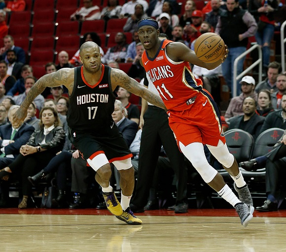 Jrue Holiday #11 of the New Orleans Pelicans drives around PJ Tucker #17 of the Houston Rockets during the fourth quarter at Toyota Center on January 29, 2019 in Houston, Texas. PHOTO/GettyImages