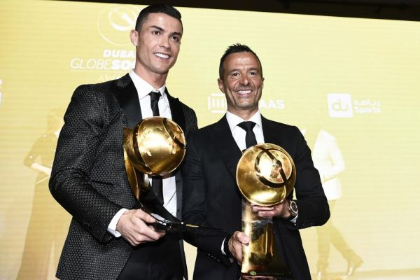 "Juventus' Portuguese forward Cristiano Ronaldo (L), holding his ""Best Player of the Year 2018 Award"" and Portuguese football agent Jorge Mendes, holding his ""Best Agent of the Year 2018 Award"" pose during the 10th edition of the Dubai Globe Soccer Awards on January 3, 2019 in Dubai. PHOTO 