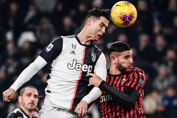 Juventus' Portuguese forward Cristiano Ronaldo (L) and AC Milan's French defender Theo Hernandez go for a header during the Italian Serie A football match Juventus vs AC Milan on November 10, 2019 at the Juventus Allianz stadium in Turin. PHOTO |AFP