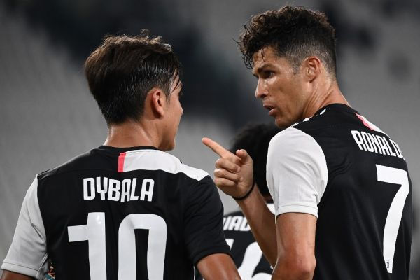 Juventus' Portuguese forward Cristiano Ronaldo celebrates with Juventus' Argentine forward Paulo Dybala (L) after scoring a penalty during the Italian Serie A football match Juventus Turin vs Atalanta Bergamo played behind closed doors on July 11, 2020 at the Juventus stadium in Turin, as the country eases its lockdown aimed at curbing the spread of the COVID-19 infection, caused by the novel coronavirus. PHOTO | AFP