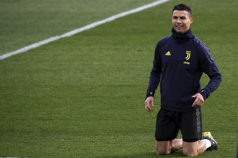Juventus' Portuguese forward Cristiano Ronaldo kneels down during a training session on the eve of the UEFA Champions League football match Juventus vs Atletico Madrid, on March 11, 2019 at the 'Juventus Training Center' in Turin. PHOTO/AFP