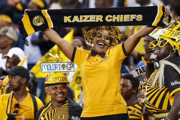 Kaizer chief's supporters cheer for their team during the Premier Soccer League (PSL) match between Kaizer Chiefs and Bloemfontein Celtic at the Moses Mabhida Stadium, in Durban, on December 7, 2019. PHOTO | AFP