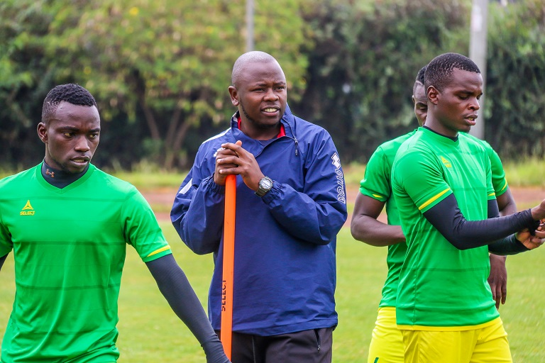 Kariobangi Sharks FC coach William Muluya with some players during a recent training session in Nairobi. PHOTO/SPN
