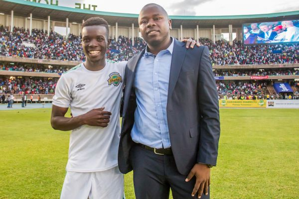 Kariobangi Sharks FC head coach, William Muluya (right) and his midfielder, Patillah Omotto pose after his team held Everton FC to a 1-1 draw before they won the subsequent shoot out 4-3 at the MISC Kasarani Stadium on Sunday, July 7, 2019. PHOTO/SPN