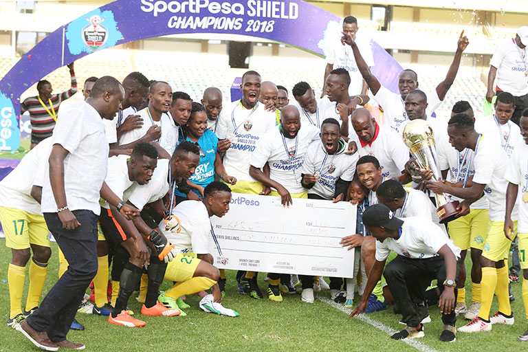 Kariobangi Sharks FC players and staff celebrate with the 2018 SportPesa Shield trophy and KSh2m dummy cheque following their 3-2 victory over Sofapaka FC at the MISC, Kasarani on Saturday, October 20, 2018. PHOTO/Stafford Ondego/www.sportpicha.com