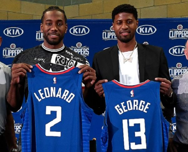 Kawhi Leonard and Paul George of the Los Angeles Clippers are introduced at Green Meadows Recreation Center on July 24, 2019 in Los Angeles, California. PHOTO/ GETTY IMAGES
