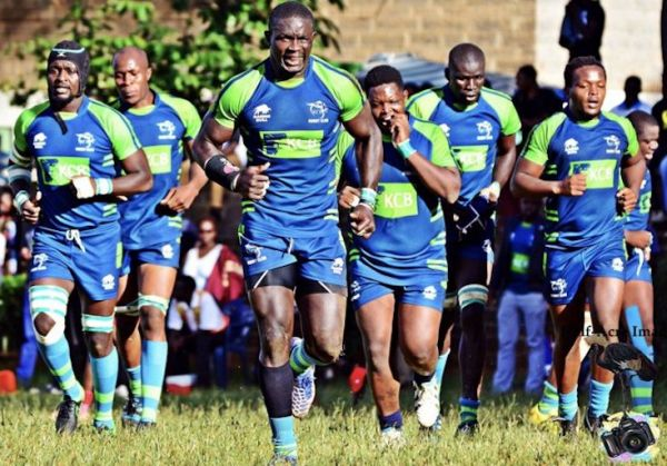 KCB RFC players led by the captain Andrew Amond (centre) race to the field. PHOTO/Courtesy