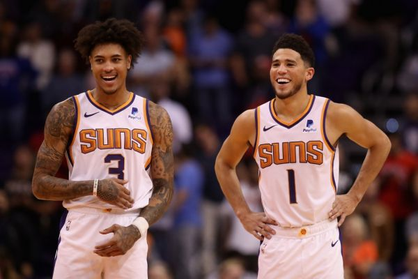 Kelly Oubre Jr. #3 and Devin Booker #1 of the Phoenix Suns react during the final moments of the second half of the NBA game against the Phoenix Suns at Talking Stick Resort Arena on November 04, 2019 in Phoenix, Arizona. The Suns defeated the 76ers 114-109. PHOTO | AFP