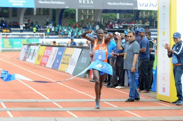 Kenya's Alex Korio crosses the finish line in 00:28:12 seconds to win the overall men's title at the TCS World 10K run in Bengaluru, on May 21, 2017. PHOTO | AFP