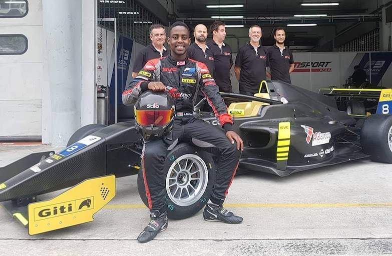 Kenya Formula 1 racing hopeful, Jeremy Wahome poses with his team in their Formula 3 paddock. PHOTO/Courtesy