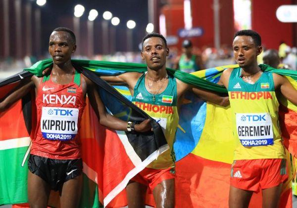 Kenya's Amos KIPRUTO, bronze, Ethiopia's Lelisa DESISA, gold, and Mosinet GEREMEW, bronze, pose for photo after the Marathon Men of IAAF WORLD ATHLETICS CHAMPIONSHIPS, DOHA 2019 in Doha, Qatar on October 6, 2019. PHOTO | AFP