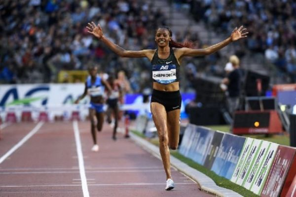 """Kenya's Beatrice Chepkoech celebrates during in the women's 3000 metres steeplechase during the IAAF Diamond League """"Memorial Van Damme"""" athletics meeting at the King Baudouin Stadium in Brussels on August 31, 2018. PHOTO/AFP"""