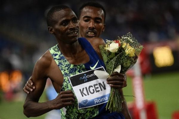 Kenya's Benjamin Kigen (L) is congratulated by Ethiopia's Getnet Wale after winning the Men's 3000m Steeplechase during the IAAF Diamond League competition on June 6, 2019 at the Olympic stadium in Rome. PHOTO/ AFP