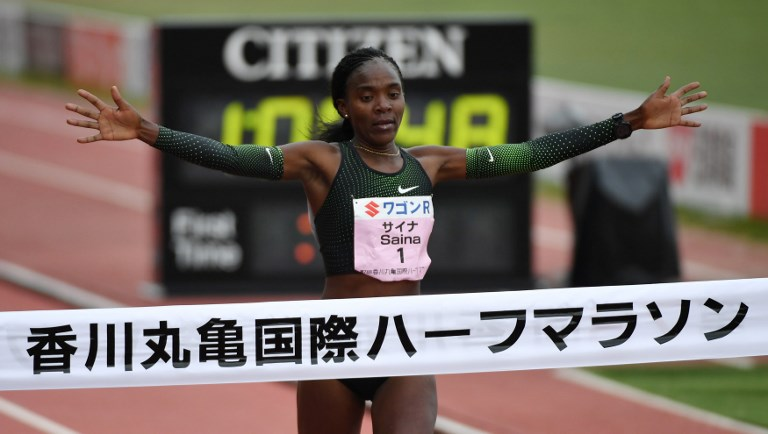 Kenya's Betsy Saina's breasts the tape of the Marugame International Half Marathon in Marugame, Kagawa Prefecture on February 3, 2019. Saina won the event. PHOTO/AFP