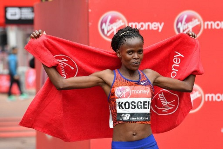 Kenya's Brigid Kosgei poses for a photograph after winning the elite women's race of the 2019 London Marathon in central London on April 28, 2019. PHOTO/AFP