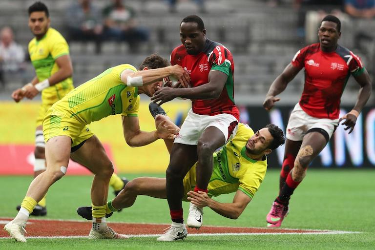 Kenya's Charles Omondi charges through the Australia defense on day two of the HSBC World Rugby Sevens Series in Vancouver on 10 March, 2019. PHOTO/Mike Lee/KLC fotos for World Rugby