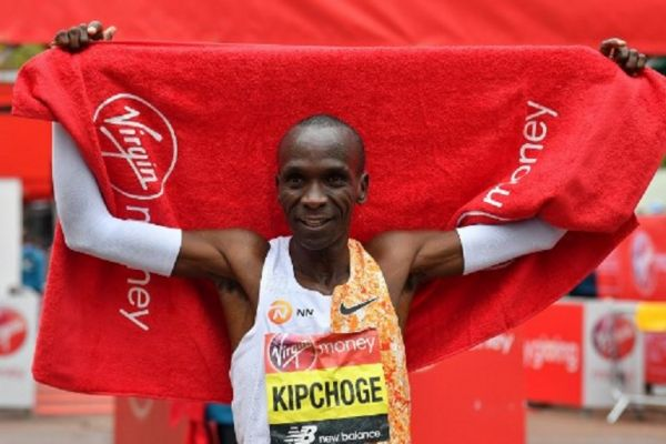 Kenya's Eliud Kipchoge poses for a photograph after winning the elite men's race of the 2019 London Marathon in central London on April 28, 2019. Kenya's Eliud Kipchoge won the men's London Marathon on Sunday in an unofficial time of 2 hours two minutes and 37 seconds -- the second fastest time for a marathon. PHOTO/AFP