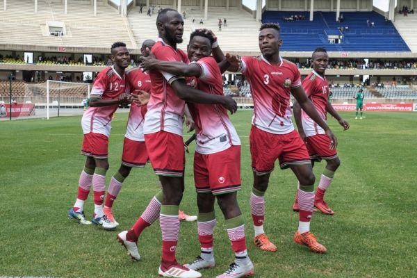 Kenya's Erick Ouma Otieno (C) celebrates with his teammates after scoring during a friendly football match against Malawi at Kasarani Stadium in Nairobi, on September 11, 2018. PHOTO | AFP