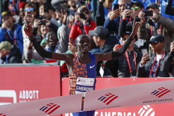 Kenya's Lawrence Cherono wins the men's 2019 Bank of America Chicago Marathon on October 13, 2019 in Chicago, Illinois. Kenya's Lawrence Cherono won a men's race that came down to the wire in 2:05:45 -- barely edging Ethiopia's Dejene Debela who was second in 2:05:46 with another Ethiopian, Asefa Mengstu, third in 2:05:48. Last year's winner Mo Farah of Britain was never a factor -- finishing a distant eighth in 2:09:58. PHOTO | AFP