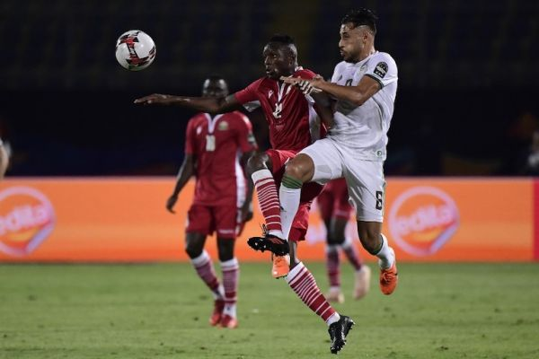 Kenya's midfielder Victor Wanyama (L) fights for the ball with Algeria's forward Youcef Belaili during the 2019 Africa Cup of Nations (CAN) football match between Algeria and Kenya at the 30 June Stadium in Cairo on June 23, 2019. PHOTO/AFP