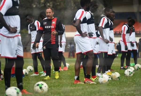 "Kenya's national football team ""Harambee Stars"" French coach Sebastien Migne (L) leads a training session on September 5, 2018, in Nairobi, ahead of the 2019 Africa Cup of Nations qualification football between Kenya and Ghana held on September 8. PHOTO 
