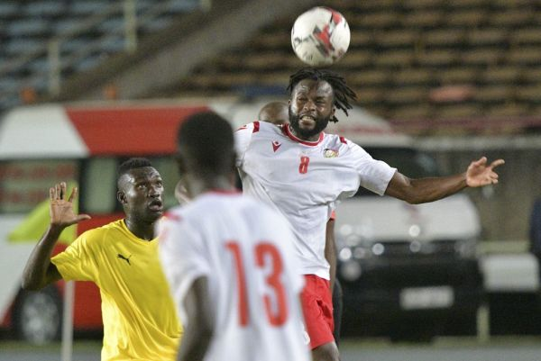 Kenya's national side, Harambee Star's Johanna Omollo(R) headers the ball as Togo's Adewale James (L) approaches November 18, 2019 during their African Cup of Nations (AFCON) qualifier football match in Nairobi. PHOTO   AFP