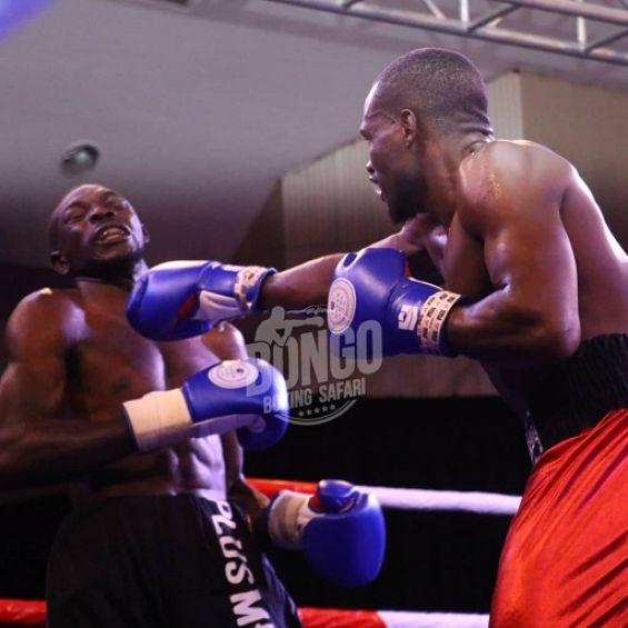 Kenya's Rayton Okwiri (right) lands a right hook on Ugandan John Serunjogi in a non-title bout in Dar es Salaam, Tanzania on Wednesday, October 13, 2021. PHOTO   Courtesy