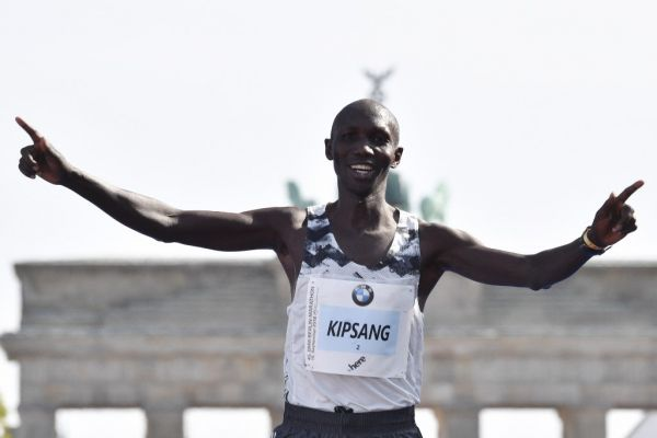 Kenya's Wilson Kipsang crosses the finish line to place third at the Berlin Marathon on September 16, 2018 in Berlin. PHOTO | AFP