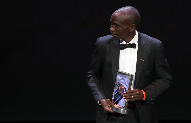 Kenyan athlete Eliud Kipchoge reacts after receing the Male athlete of the year award during the IAAF athlete of the year awards ceremony, on December 4, 2018 in Monaco. PHOTO/AFP