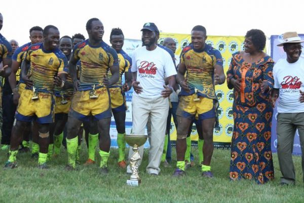 Kisumu County Governor, Prof. Anyang' Nyong'o does a jig with Homeboyz RFC players when they won the Dala 7s in the lake side city last season. PHOTO/File