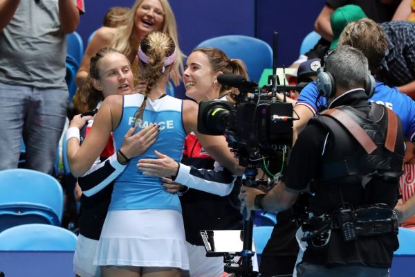 Kristina Mladenovic (C) of France celebrates her victory against Ashleigh Barty of Australia with teammates during the third rubber of the Fed Cup tennis final match between Australia and France in Perth on November 10, 2019. PHOTO | AFP