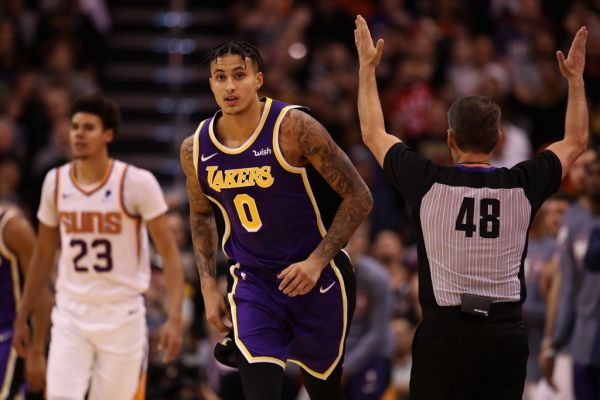 Kyle Kuzma #0 of the Los Angeles Lakers reacts after hitting a three point shot over Cameron Johnson #23 of the Phoenix Suns during the second half of the NBA game at Talking Stick Resort Arena on November 12, 2019 in Phoenix, Arizona. The Lakers defeated the Suns 123-115. PHOTO | AFP