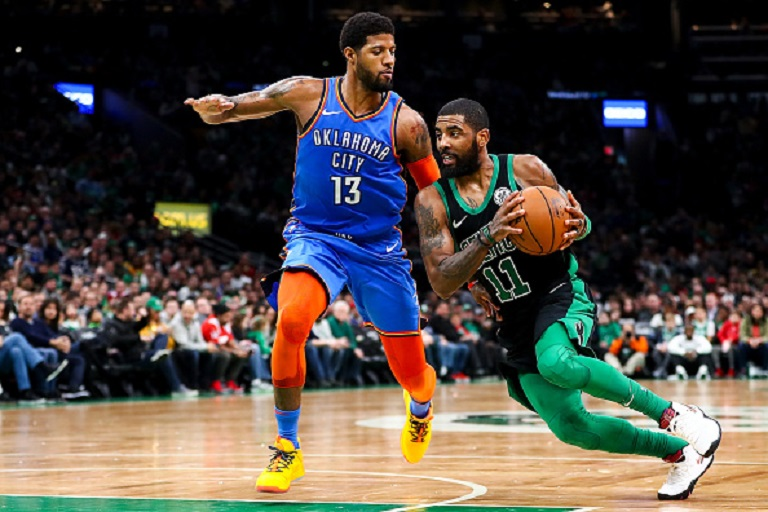 Kyrie Irving #11 of the Boston Celtics drives to the basket past Paul George #13 of the Oklahoma City Thunder during a game at TD Garden on February 3, 2019 in Boston, Massachusetts. PHOTO/GettyImages