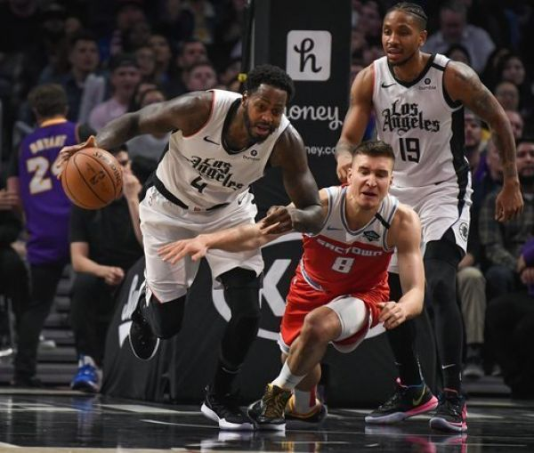 LA Clippers forward JaMychal Green (4) grabs a loose ball away from Sacramento Kings guard Bogdan Bogdanovic (8) during the fourth quarter at Staples Center. PHOTO | AFP