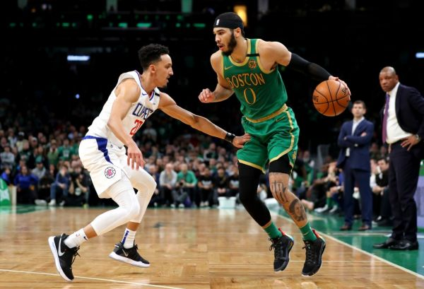Landry Shamet #20 of the LA Clippers defends Jayson Tatum #0 of the Boston Celtics at TD Garden on February 13, 2020 in Boston, Massachusetts. The Celtics defeat the Clippers in double overtime 141-133. PHOTO | AFP