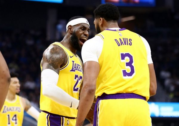 LeBron James #23 congratulates Anthony Davis #3 of the Los Angeles Lakers after he made a basket against the Golden State Warriors at Chase Center on October 05, 2019 in San Francisco, California. PHOTO | AFP