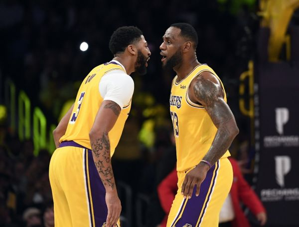 LeBron James #23 is congratulated by Anthony Davis #3 of the Los Angeles Lakers after scoring a basket against Memphis Grizzlies during the second half at Staples Center on October 29, 2019 in Los Angeles, California. PHOTO | AFP