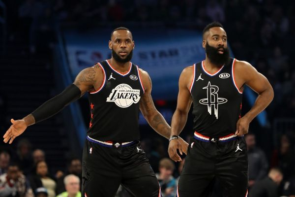 LeBron James #23 of the LA Lakers and James Harden #13 of the Houston Rockets both of Team LeBron look on as they play against Team Giannis in the first quarter during the NBA All-Star game as part of the 2019 NBA All-Star Weekend at Spectrum Center on February 17, 2019 in Charlotte, North Carolina. PHOTO | AFP