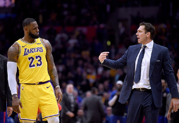 LeBron James #23 of the Los Angeles Lakers and Luke Walton talk during a timeout during a 123-120 win over the LA Clippers at Staples Center on January 31, 2019 in Los Angeles, California. PHOTO/GettyImages