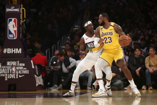 LeBron James #23 of the Los Angeles Lakers handles the ball against Jrue Holiday #11 of the New Orleans Pelicans during the first half at Staples Center on February 25, 2020 in Los Angeles, California. PHOTO | AFP