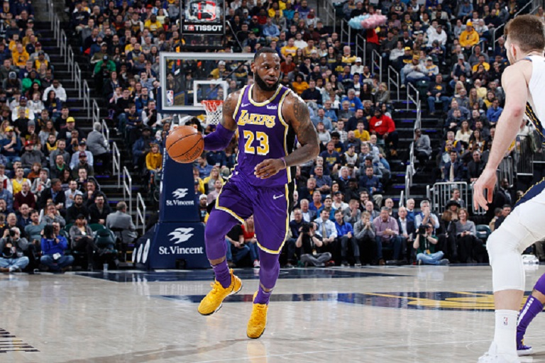 LeBron James #23 of the Los Angeles Lakers handles the ball against the Indiana Pacers in the first half of the game at Bankers Life Fieldhouse on February 5, 2019 in Indianapolis, Indiana. The Pacers won 136-94. PHOTO/GettyImages